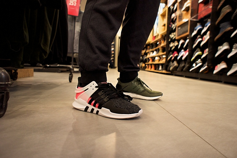 "Customer trying on a pair of adidas EQT Support ADV ""Turbo Red"" at Foot Locker on 247 Yonge Street"